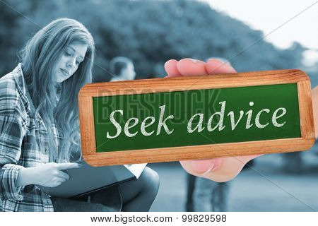The word seek advice and hand showing chalkboard against pretty student studying outside on campus