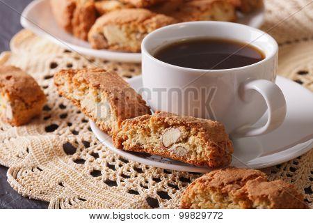 Black Coffee And Italian Cookies Cantuccini Macro. Horizontal