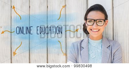 The word online education against stylish brunette thinking and smiling