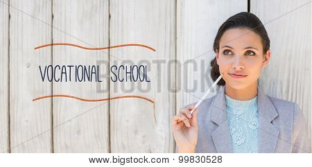 The word vocational school against stylish brunette thinking and smiling