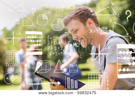 math against handsome student studying outside on campus