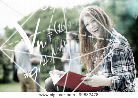 Math problems against pretty student studying outside on campus