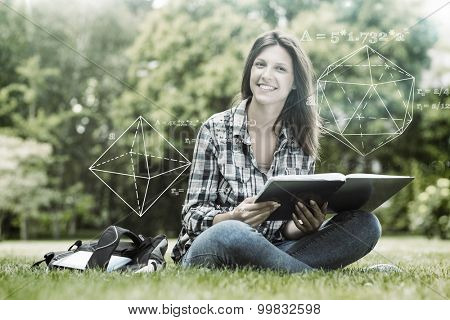 geometry problem against smiling student sitting and holding a book