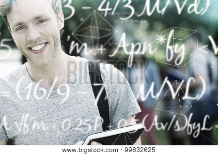 Maths equation against handsome student smiling at camera outside on campus