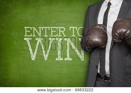 Enter to win on blackboard with businessman on side