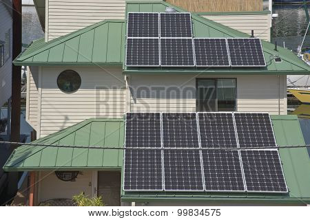 Solar Panels On Rooftops On A Floating House.