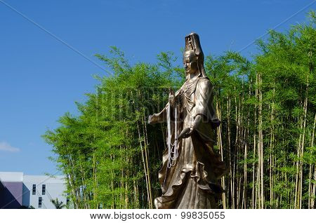 Guan Yin, Goddess Of Mercy, With Bamboo Garden In Background