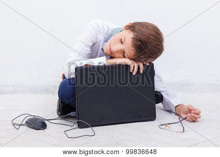 Boy using his laptop computer