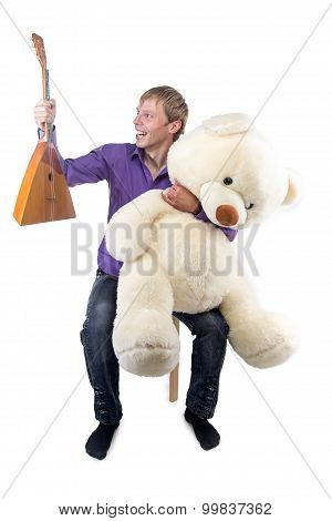 Image smiling man with balalaika, teddy bear