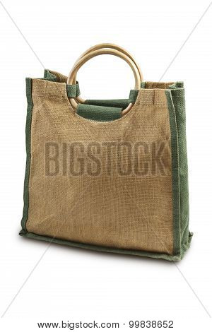 A Recycled Hessian Or Jute Shopping Bag With Wooden Handles Isolated On White.
