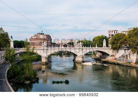 bridge over the Tiber river and Saint Angel castle Rome