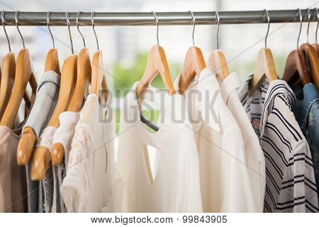 Clothes on clothes rail in clothing store