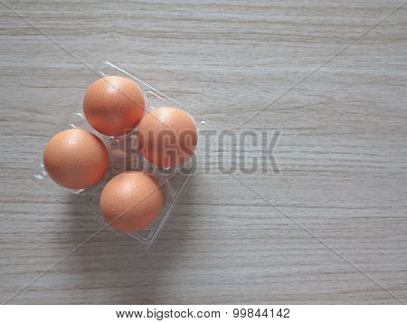 Closeup of a brown egg on a  table