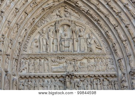 PARIS, FRANCE - SEPTEMBER 8, 2014: Paris - West facade of Notre Dame Cathedral. The Saint Anne portal and tympanum