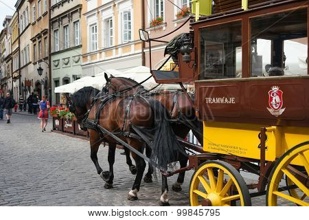 Warsaw, Poland - june 20, 2015: passing by carriage on Warsaw street in Poland