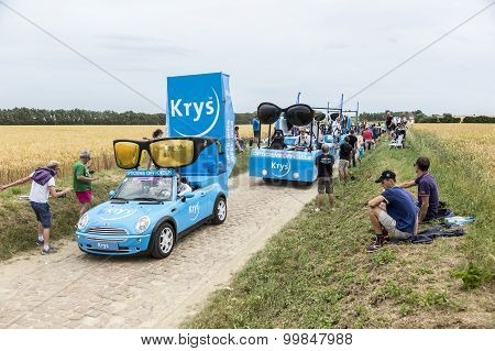 Krys Caravan On A Cobblestone Road- Tour De France 2015