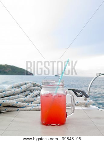 Colorful cocktail drink on  sea & sky background