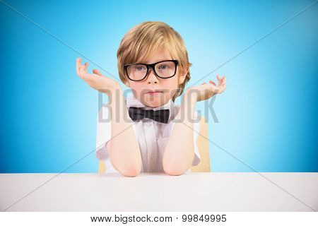 Cute pupil looking confused against blue background with vignette
