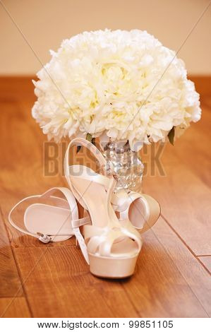 Beautiful Wedding Bouquet With Bride's Shoes On Wooden Floor