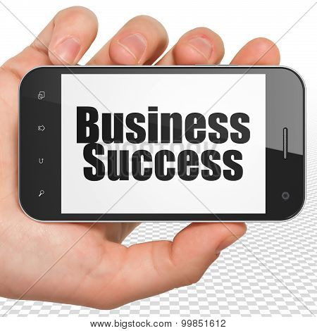 Finance concept: Business Success on Hand Holding Smartphone display