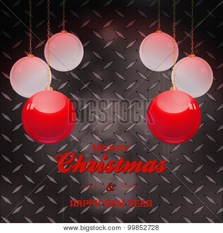 Christmas Baubles And Text Over Black Metal Plate