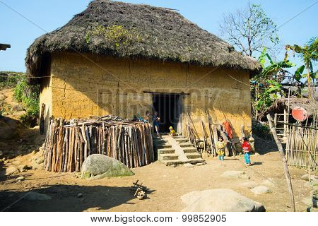 Hani ethnic minority people near their traditional house in Laocai, Vietnam