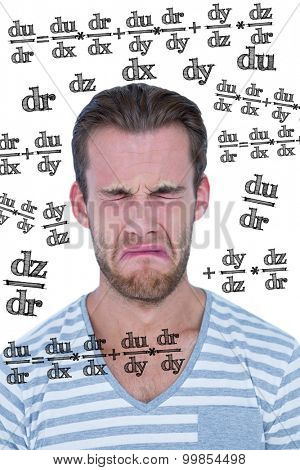 Casual man crying in front of camera against math equation