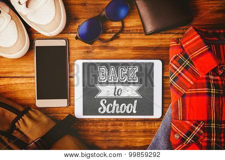 Back to school message against tablet shoes shirt jean wallet and bag