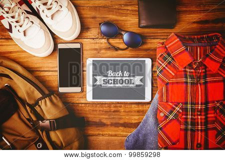 Back to school message against shirt shoes jean glasses next to wallet smartphone and bag