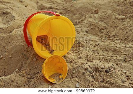 Yellow Childrens Bucket And Mold, Lying In Sandbox