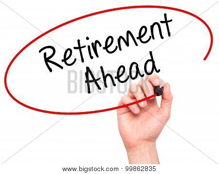 Man Hand writing Retirement Ahead with black marker on visual screen.