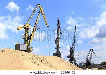 landscape with construction cranes