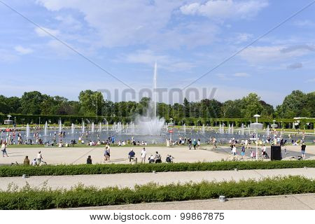 WROCLAW - JULY 19: People cooling using public fountains in the hottest day on 19 July 2015 in Wroclaw, Poland. In this year there was a record high temperature in Wroclaw.