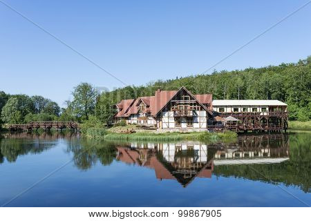 CHARLOTTA VALLEY - JULY 07: House on the water on 7 July 2015 in Charlotta Valley near Ustka, Poland. Charlotta Valley is known for its Rock Legend Festival, performed here Santana, Plant, ZZ-Top.