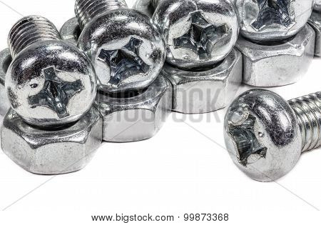 Closeup metal screw (bolt) and nuts on white background.