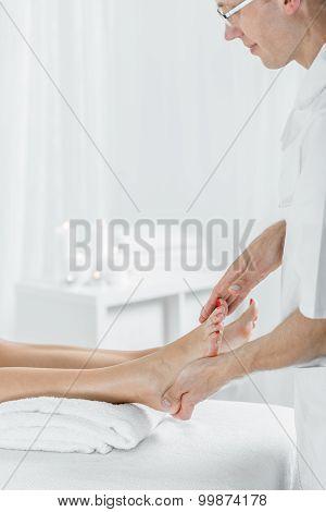 Masseur Doing Foot Massage