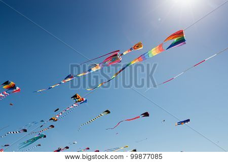 Large colorful kites with sun flare