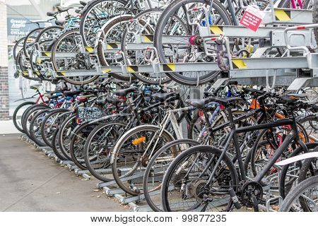 Parked Rows Of Commuter Bikes At A Train Station