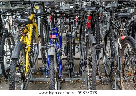 Locked Rows Of Commuter Bikes At A Train Station