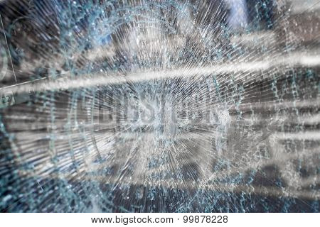 Fractured Glass Window With Urban Train Station Reflection In The Glass