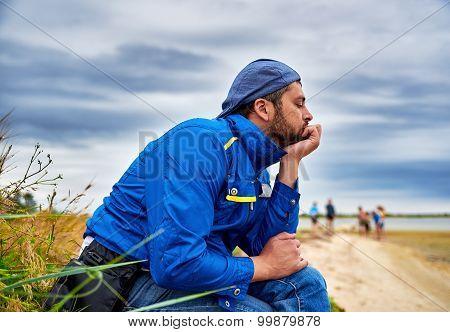 Pensive Man On Sea Background