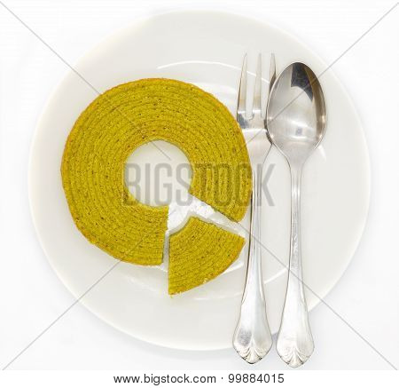 Multiple layers green tea cake on wooden disk