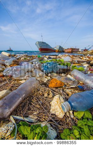 Colon, Panama - April 15, 2015: Waste And Pollution Washing On The Shores Of The Beach In City Of Co