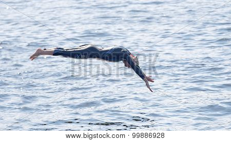 Female Swimmer Diving Into The Water
