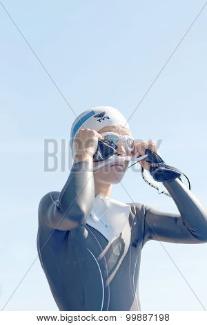Female Swimmer Fixing The Glasses