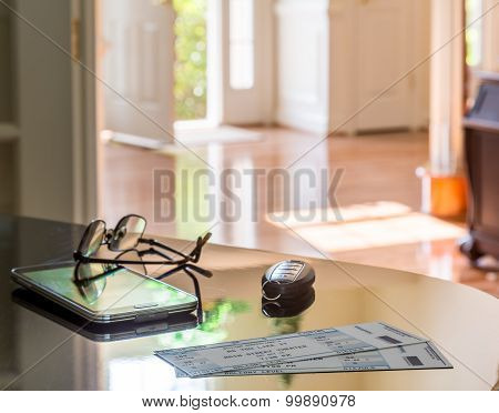 Pair Of Theater Tickets On Table With Front Door