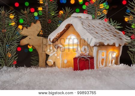 Gingerbread House With Gingerbread Man, Elk And Christmas Trees. Gingerbread Man Cookie Behind The D
