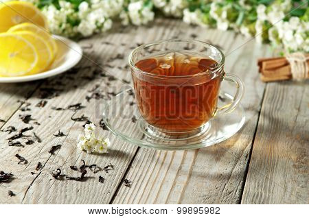 Black Tea In A Glass Cup And Saucer