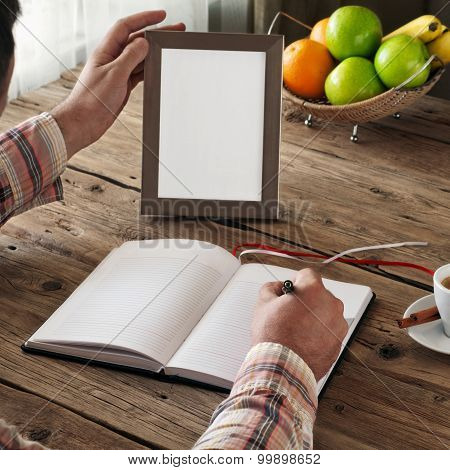 Hand Of Man Writing In A Blank Notebook