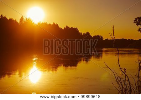 Evening sunset on the river sun sets orange light silhouettes th